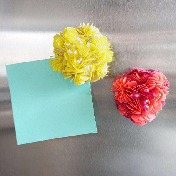 Yellow pink flower magnets