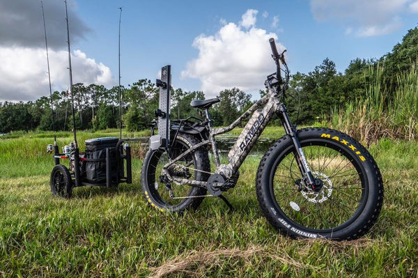 Rebel Truetimber outdoors with fishing cart.