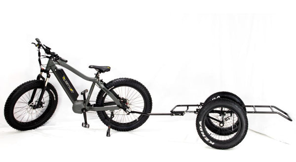 A Quietkat ebike with the cargo trailer - 2 wheel attached. White background. Side profile.
