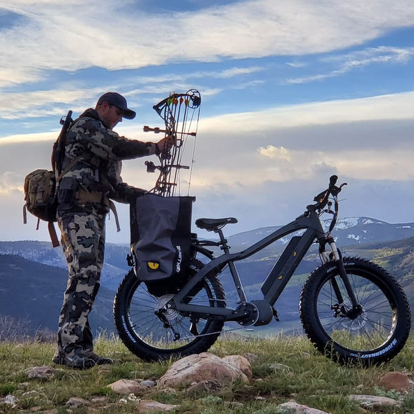 Hunter with Quietkat eBike and Bow