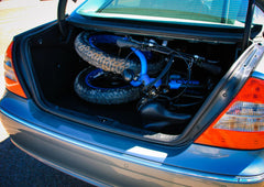 Lynx ebike folded and inside car trunk