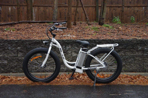 image of Big Cat Long Beach Cruiser XL 500 Electric Bike on the road facing left side profile