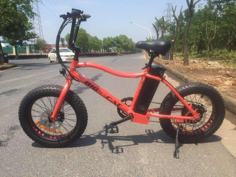 image of Big Cat USA Mini Cat XL 500 Electric Bike on the road side profile facing left color red