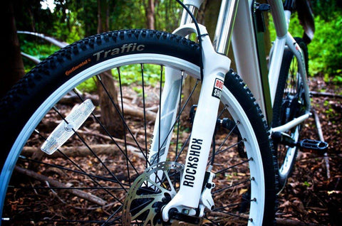 image of Prodecotech Phantom X RS Electric Mountain Bike color polar white gloss close up of front wheel suspension
