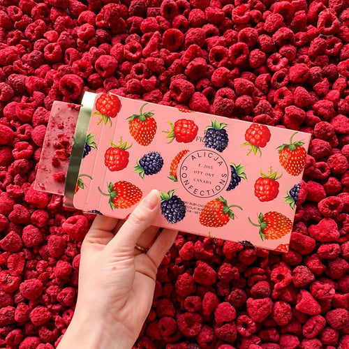 Alicja Confections: RUBY FRAOULA • FREEZE DRIED STRAWBERRY, BLACKBERRY, AND RASPBERRY 47.3% RUBY CHOCOLATE