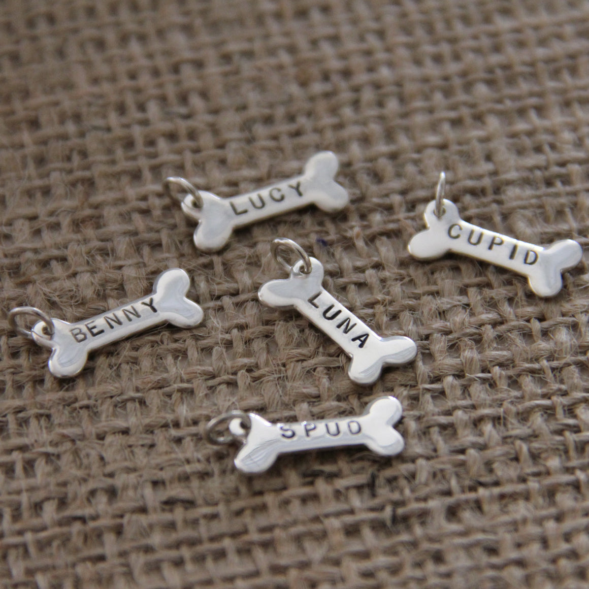 personalized hand stamped sterling silver dog bone charm, dog lover jewelry