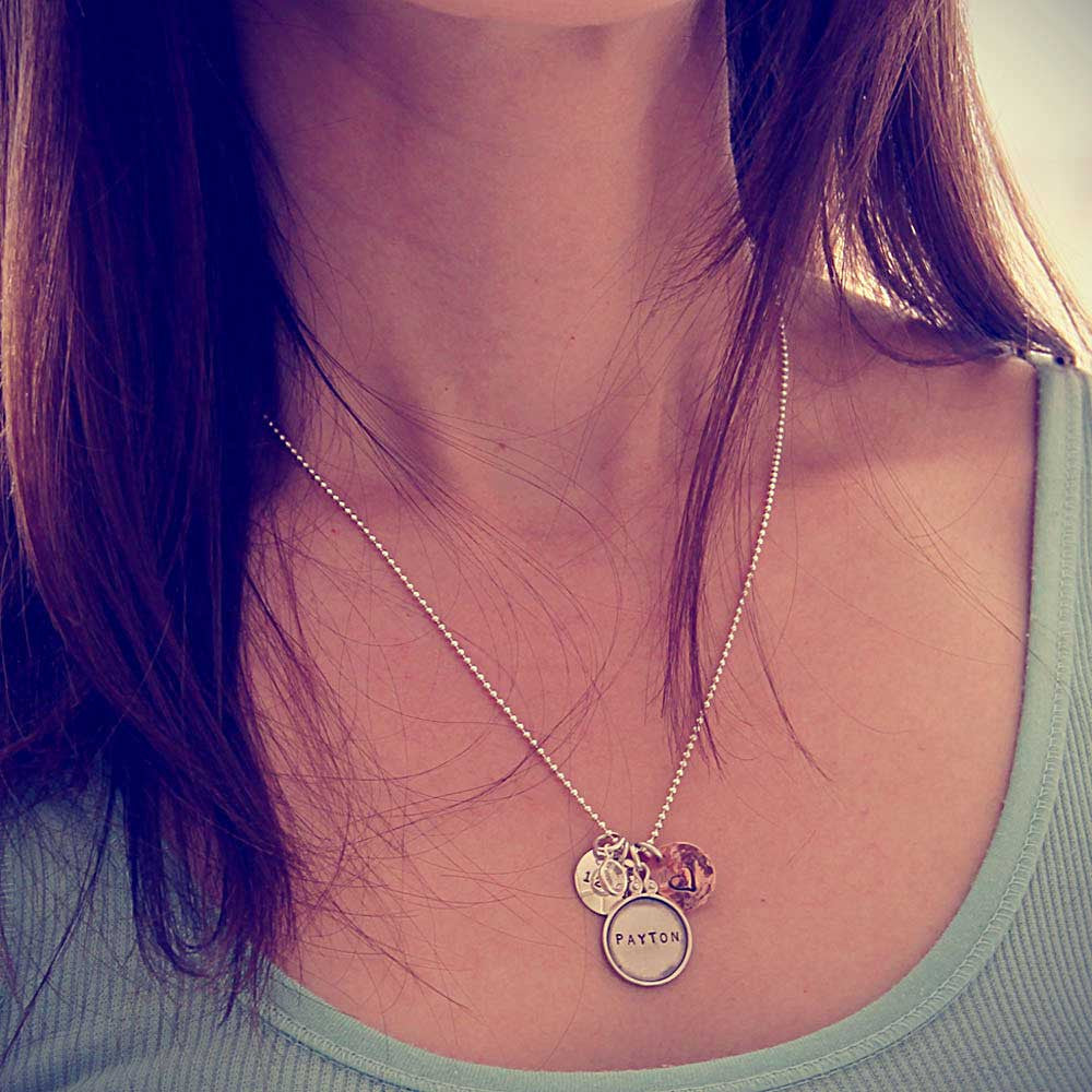model wearing hand stamped new mom name tag necklace, personalized jewelry, proud mama®