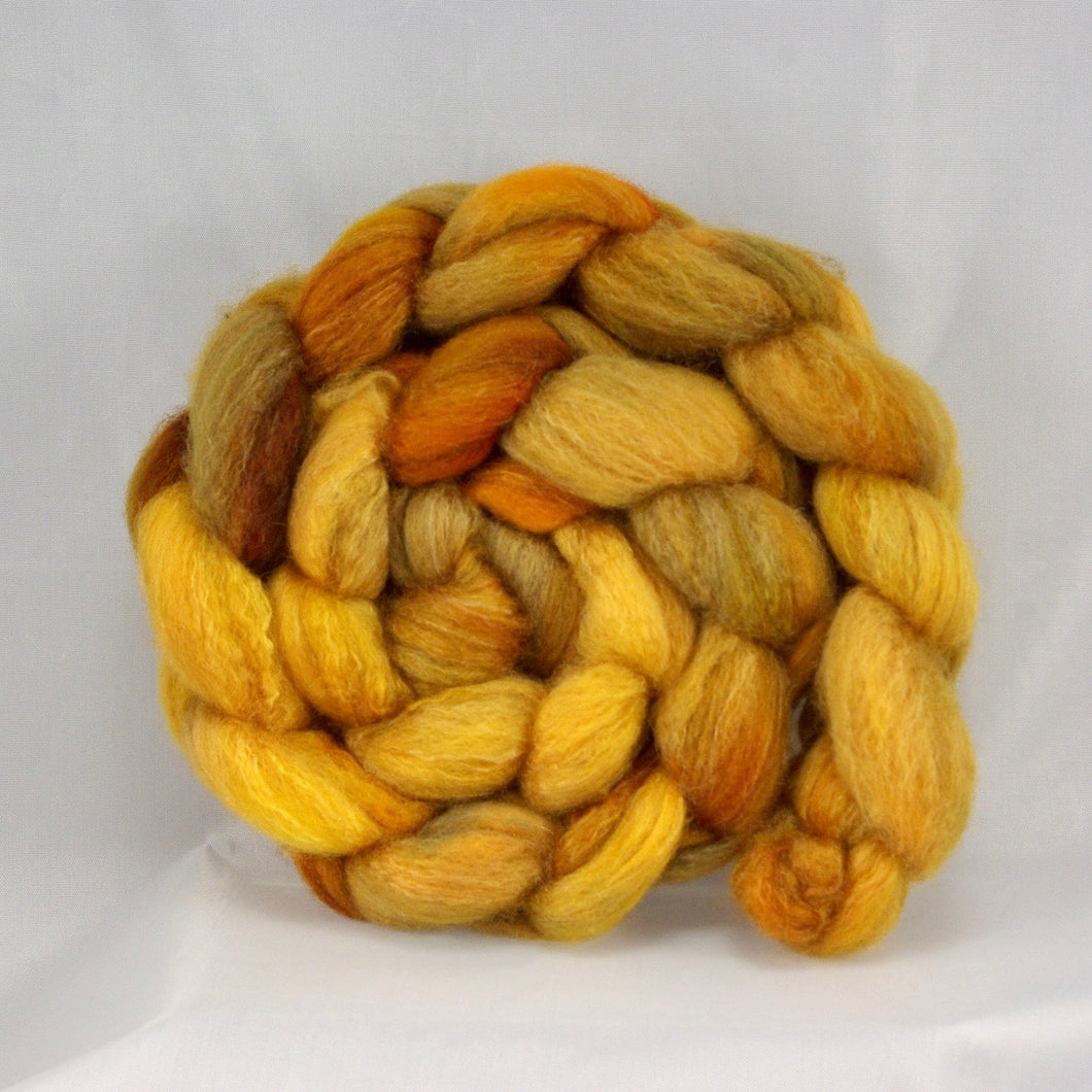 hand-dyed bfl/silk dyed in golden, warm tones of yellow and orange