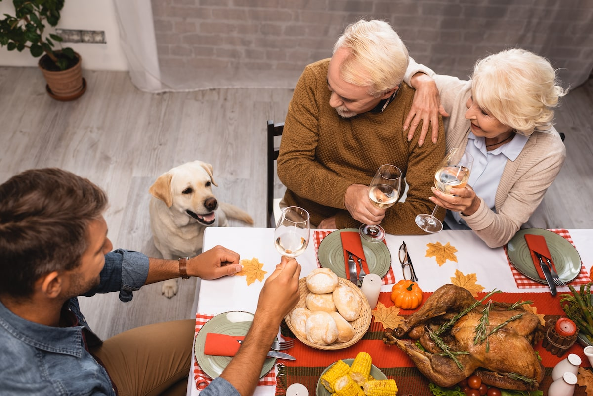 family with dog on thanksgiving