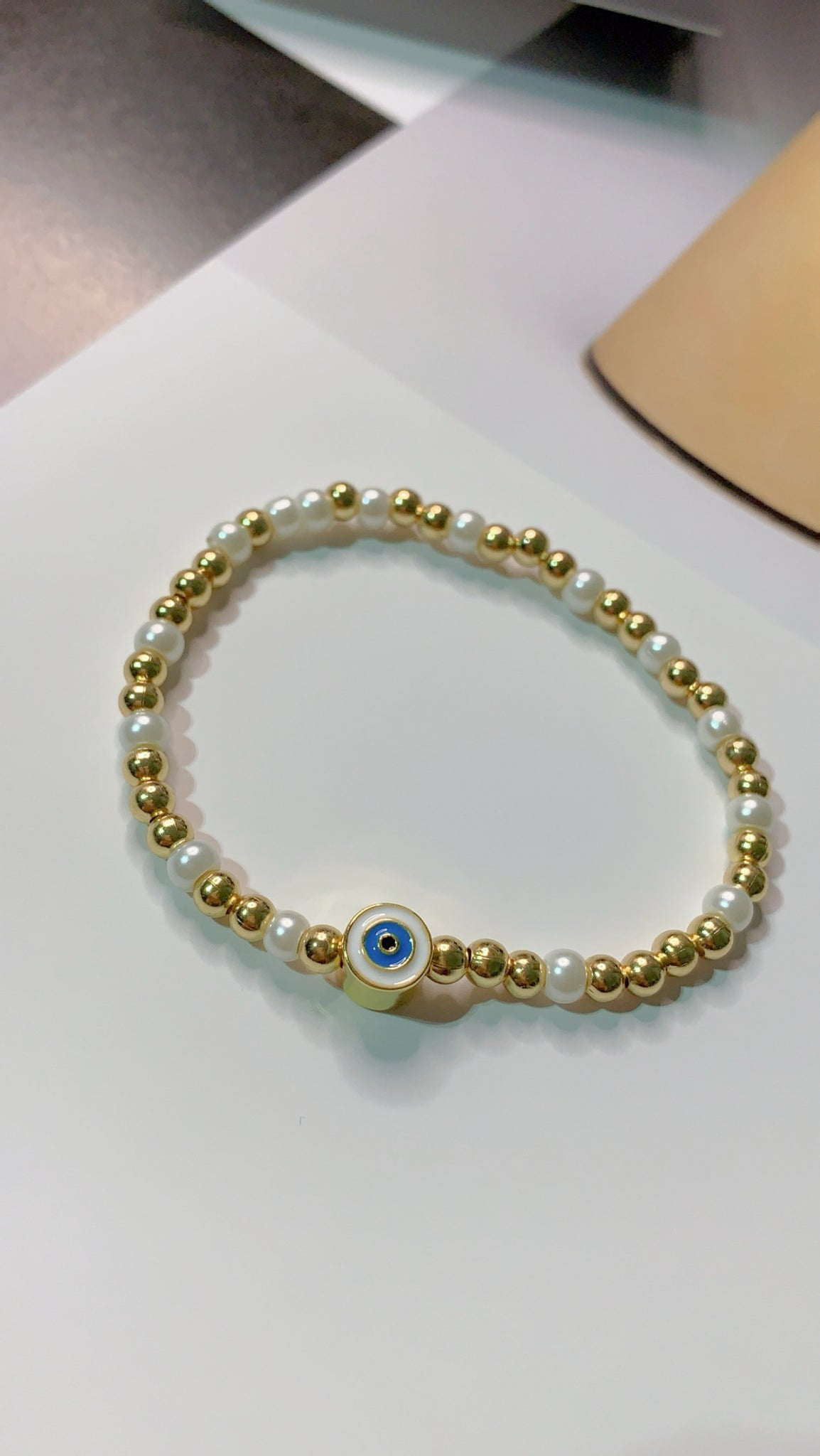 Pearls and Gold Evil Eye Bracelets