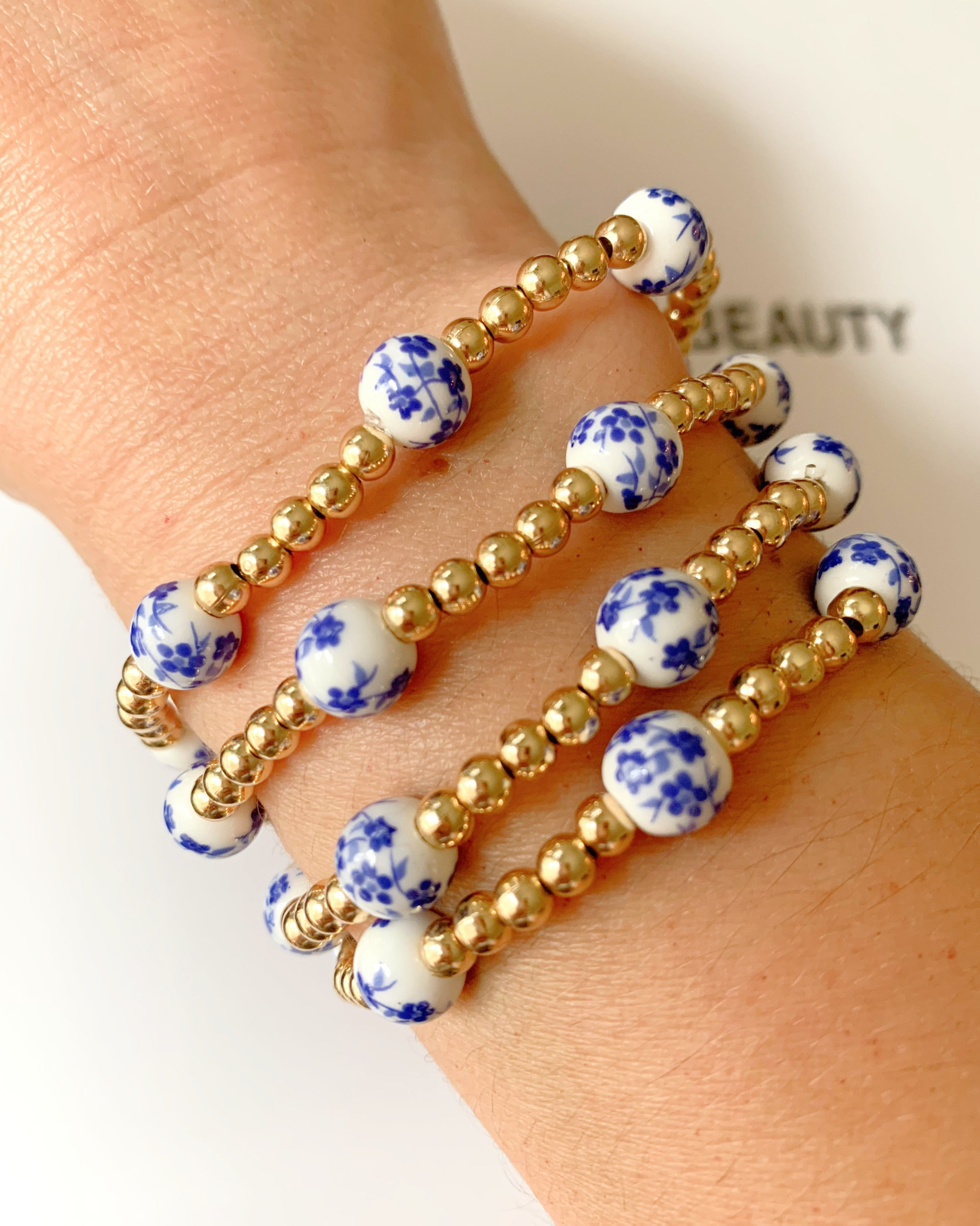 Blue Floral gold beaded bracelet