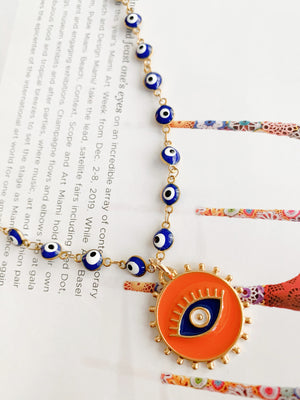 Orange pendant and blue evil eye necklace