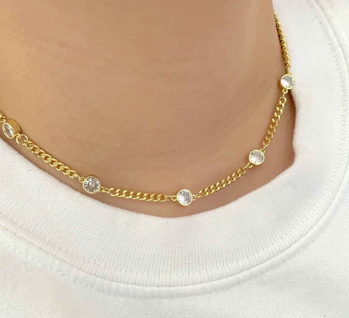 Gold short necklace with clear stones