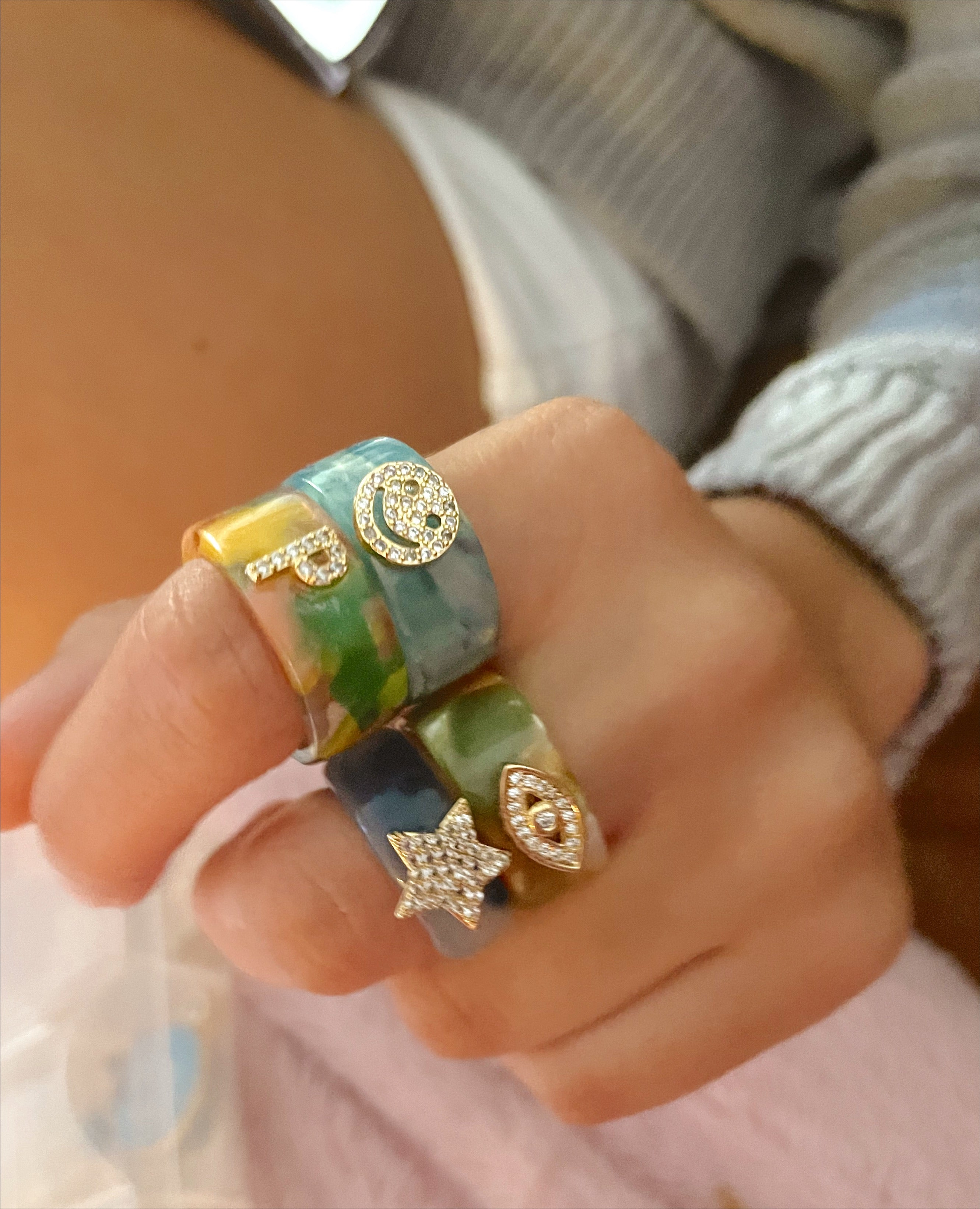 Embellished acrylic rings with charm