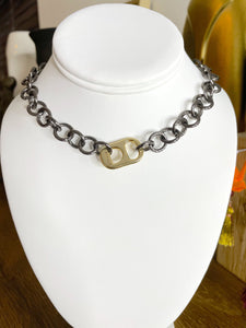 Chunky rhodium necklace with gold soda cap