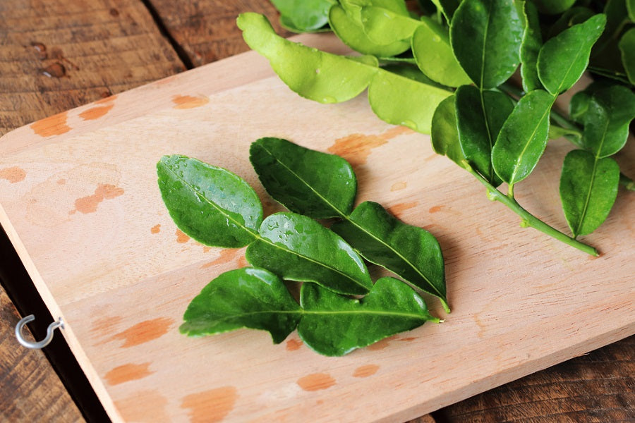 Kaffir Lime Leaves on Cutting Board