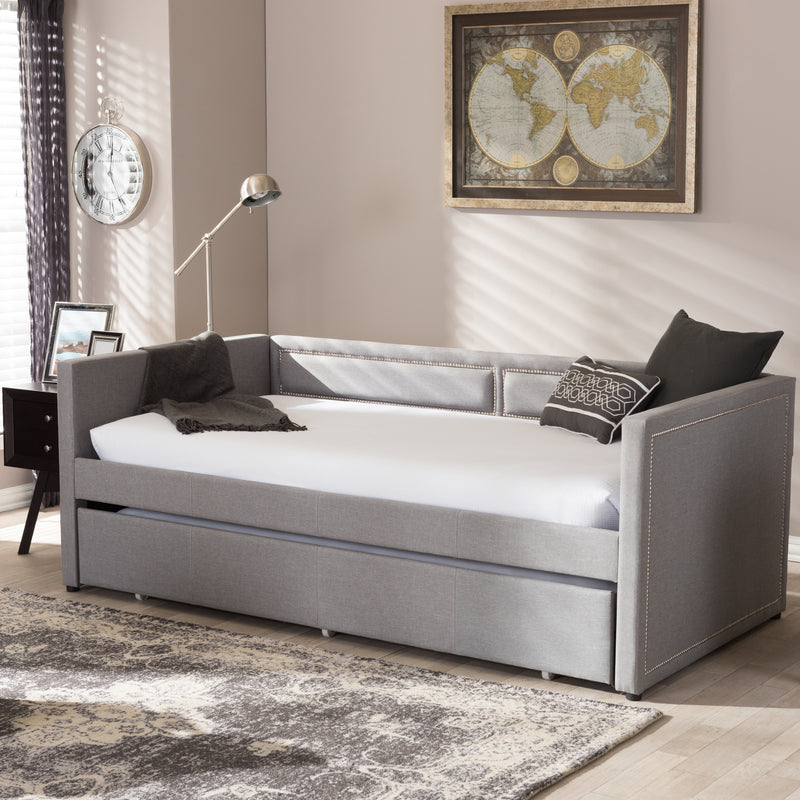 Raymond   Grey Fabric Nail Heads Trimmed Sofa Twin Daybed with Roll-Out Trundle Guest Bed