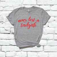 Never Lost a Tailgate Shirt Women's Football T-shirt Sporting Event Graphic Tee Sports Fantasy Graphic Tee Your Team Colors Shirt Unisex