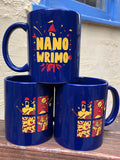 Royal blue double sided mug. One on side, a red and yellow castle turret on top of the word NANOWRIMO in large yellow letters. Red and yellow leaves, stars, rosebuds, and confetti surround the word.