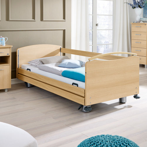 Libra care bed with full length integrated continuous side rails on both sides