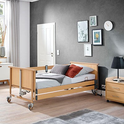 NEW - Dali Econ homecare bed with full length integrated side rails on both sides, including patient lifting pole