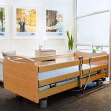 Libra care bed with full length split (KSG) side rail on the right and full length integrated (DSG) side rail on the left