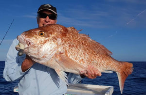 Andy with a huge Snapper caught on downrigger shop big soft plastics