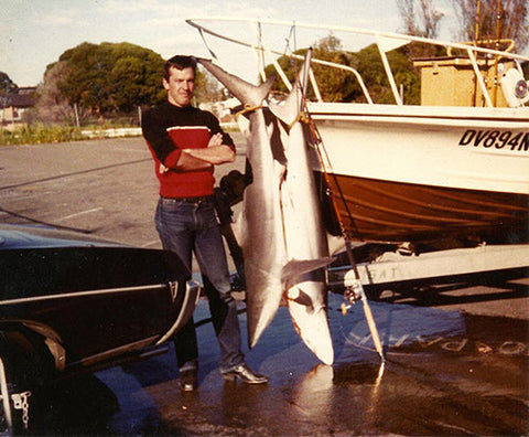 Andy with two sharks freshly caught and his Pontiac