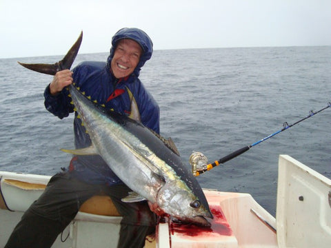 Andy with a Yellowfin Tuna caught on a Downriggershop bent butt rod