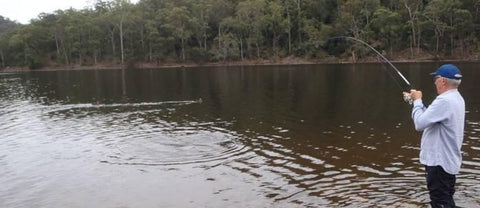Reeling in a carp at Kangaroo Valley