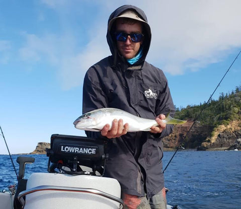 Jay with a small Kingfish jigged inshore