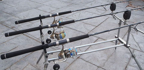 Three rods resting in their rod holder positions