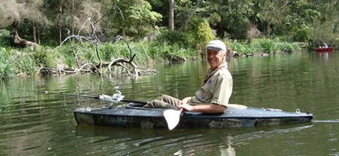 Andy with a rod holder attached to his Kayak