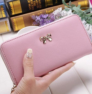ladies cell phone wallet that holds cards, cash and phone