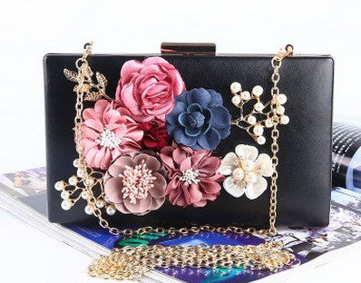 black evening bag with flower details