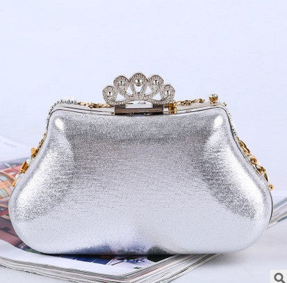 back of white and gold evening bag adorned with beads and diamantes
