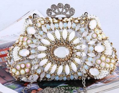 white and gold evening bag adorned with beads and diamantes