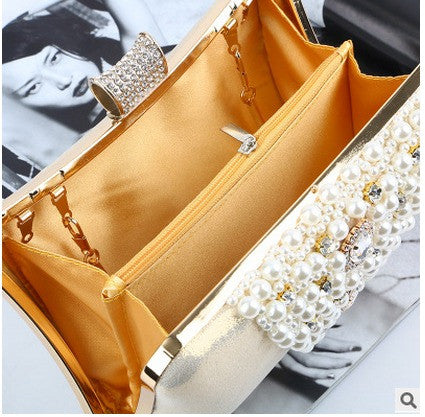 inside of gold beaded evening bag