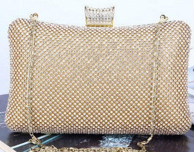 gold evening bag with shoulder strap