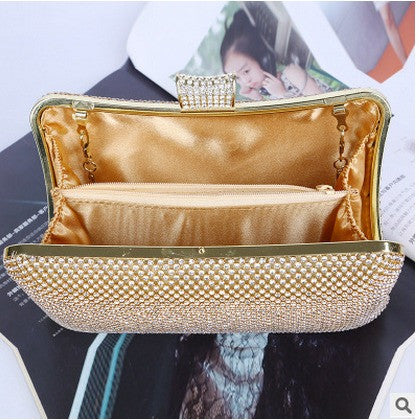 inside of gold evening bag with shoulder strap