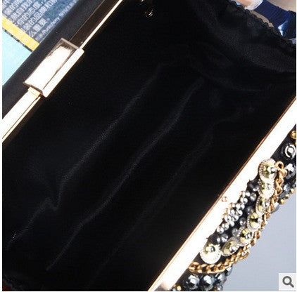 inside of black white and gold beaded evening bag