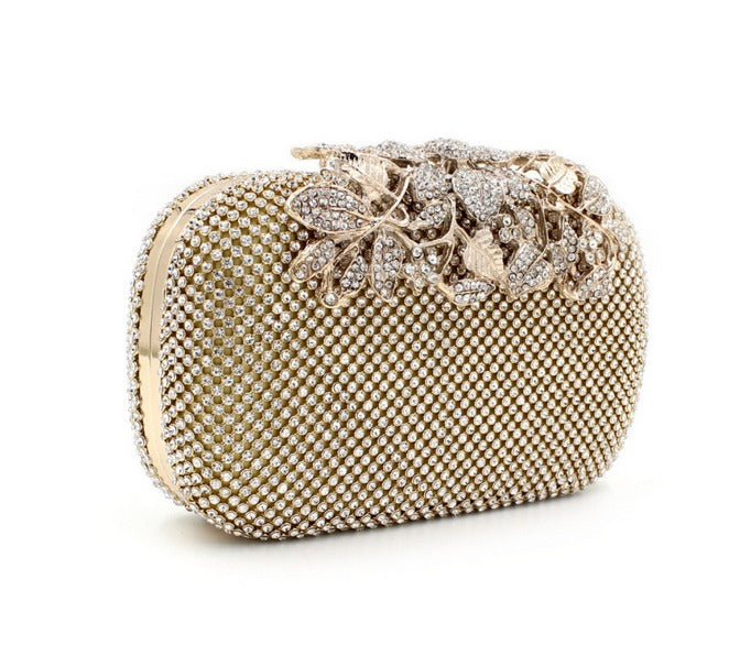 side view of gold clutch evening bag