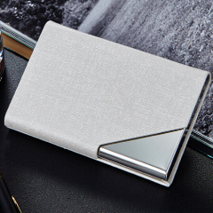 Grey minimalist wallet holds cash and cards