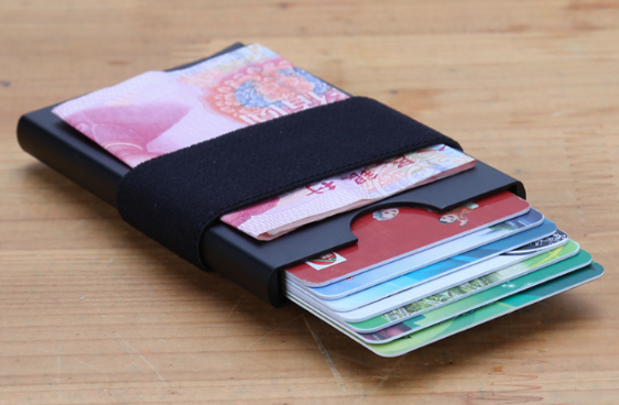 metallic strap wallet holds cash and cards