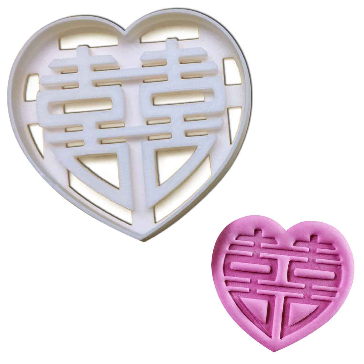 chinese wedding cookie cutter (heart outline) pressed on fondant
