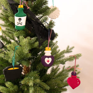 set of 3 toxic bottle, love potion, and health potion clay ornaments on christmas tree