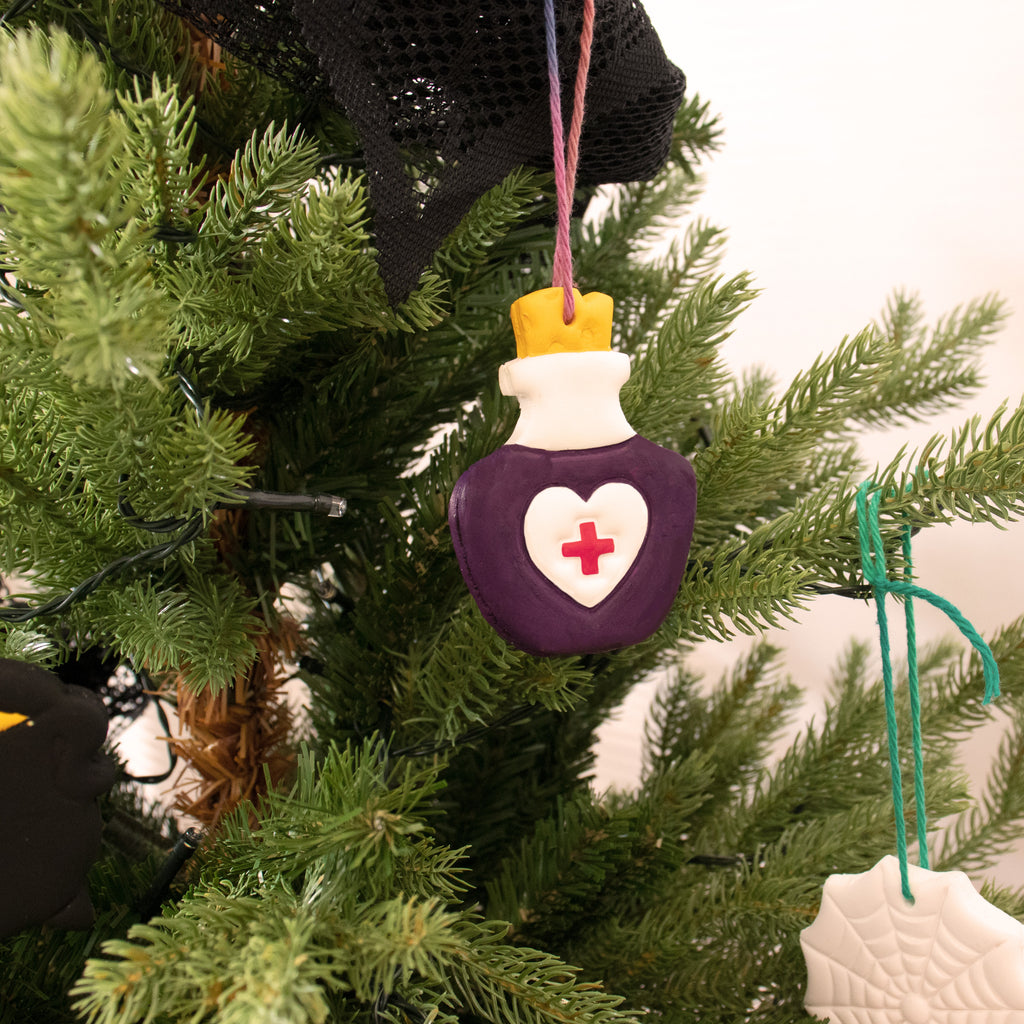 halloween health potion clay ornament on christmas tree