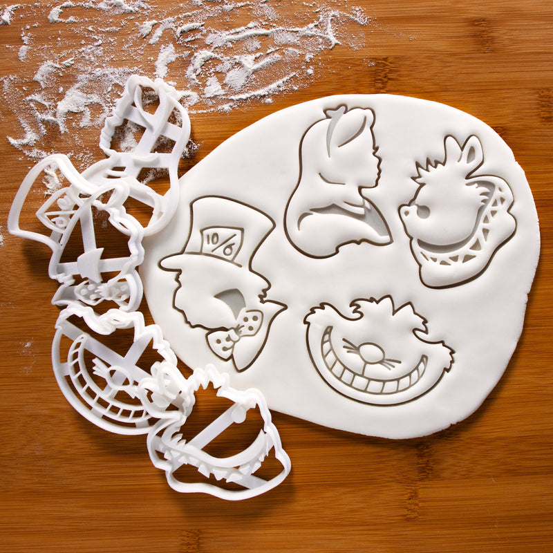 set of 4 alice's adventures in wonderland characters cookies with fondant - alice kingsley, mad hatter, cheshire cat, white rabbit