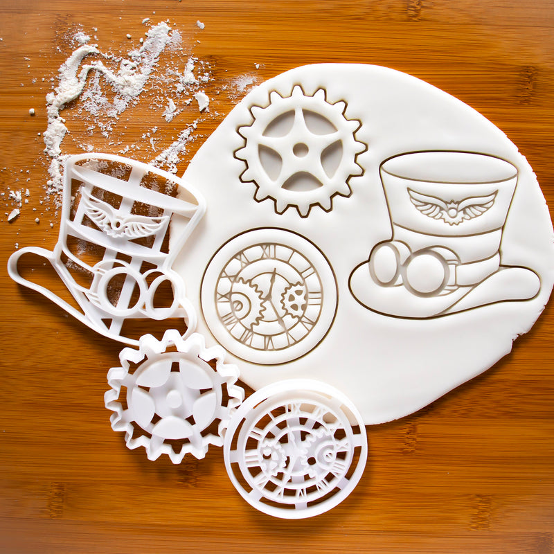 set of 3 steampunk cookie cutters, featuring a hat, a gear and a clock.