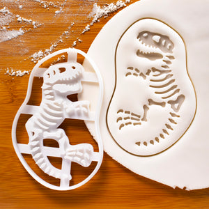 t-rex dinosaur fossil cookie cutter pressed on white fondant